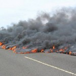 lava flow crosses Hawaiian road