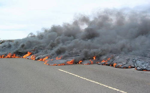 Lava flow crosses a road in Hawaii