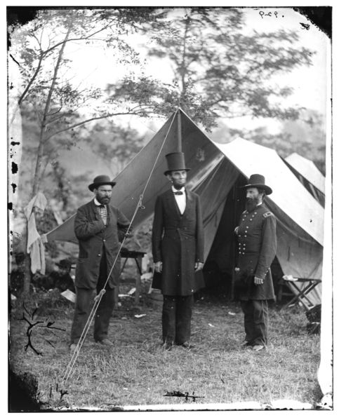 Lincoln and company standing in front of a tent