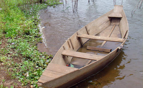 wooden boat on water's edge
