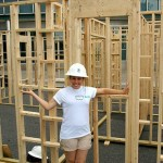 woman and a framed Habitat for Humanity house
