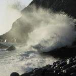 ocean wave hits cliffs