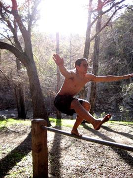 balancing on a rail in the sun